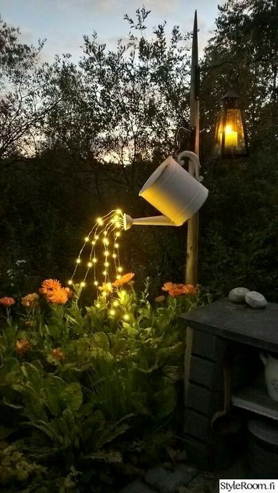 Water can with fairy lights ..                              nice  #garden decoration idea for night .