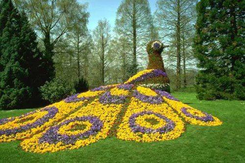 bird sculpture garden with colorful flowers.