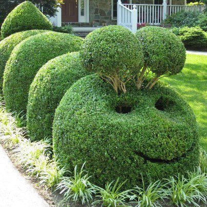 Add a smile to your garden with sculptures..
