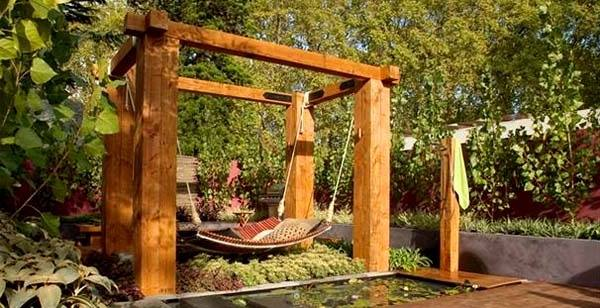 relax on wood hammock at beautiful outdoor garden..to buy this awesome product visit http://www.sharpexindia.com/product/accessories/wood-hammock-5/