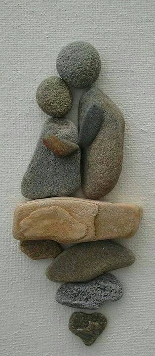 Nice rock art! Scenes like this would be great on an outdoor garden wall.